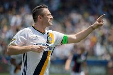 May 8, 2016; Carson, CA, USA; LA Galaxy forward Robbie Keane (7) celebrates after scoring a goal against the New England Revolution during the first half at StubHub Center. Mandatory Credit: Kelvin Kuo-USA TODAY Sports