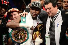 Sep 12, 2015; Las Vegas, NV, USA; Floyd Mayweather celebrates after defeating Andre Berto (not pictured) in their WBA/WBC welterweight title bout at MGM Grand Garden Arena. Mayweather won via unanimous decision. Mandatory Credit: Joe Camporeale-USA TODAY Sports