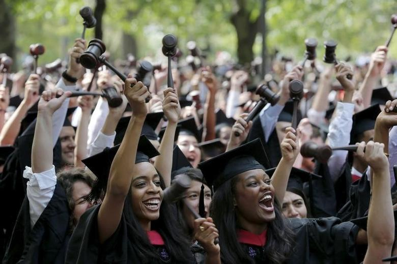 Students graduating from the School of Law cheer as they receive their degrees during the 364th Commencement Exercises at Harvard University in Cambridge, Massachusetts May 28, 2015.    REUTERS/Brian Snyder