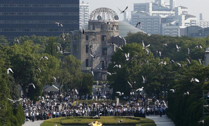Doves fly over the Peace Memorial Park with the Atomic Bomb Dome in the background, at a ceremony in Hiroshima, western Japan, August 6, 2015, on the 70th anniversary of the atomic bombing of the city.