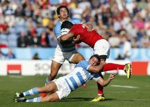 Rugby Union - Argentina v Tonga - IRB Rugby World Cup 2015 Pool C - Leicester City Stadium, Leicester, England - 4/10/15 Argentina's Matias Moroni and Santiago Cordero in action with Tonga's Siale Piutau Action images via Reuters / Andrew Boyers Livepic