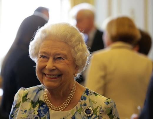 Britain's Queen Elizabeth II smiles during a reception with parliamentarians to mark the Queen's 90th birthday at Buckingham. Photo: REUTERS/PAUL HACKETT