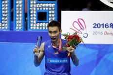 Badminton - 2016 Badminton Asia Championships - Men's singles final - Wuhan, China 1/5/16. Lee Chong Wei of Malaysia poses with trophy and medal after beating Chen Long of China. REUTERS/Darley Shen