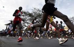 Runners compete at the start of the Nairobi marathon in Nairobi Kenya, October 29, 2006. REUTERS/Radu Sigheti/File Photo