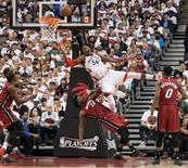 May 15, 2016; Toronto, Ontario, CAN; Toronto Raptors forward Patrick Patterson (54) drives to the basket as Miami Heat forward Justise Winslow (20) tries to defend during the second quarter in game seven of the second round of the NBA Playoffs at Air Canada Centre. Mandatory Credit: Nick Turchiaro-USA TODAY Sports