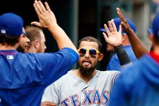 May 7, 2016; Detroit, MI, USA; Texas Rangers second baseman Rougned Odor (12) celebrates with teammates in the dugout after scoring a run in the sixth inning against the Detroit Tigers at Comerica Park. Mandatory Credit: Rick Osentoski-USA TODAY Sports