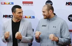 Boxing - Vladimir Klitschko and Tyson Fury News Conference - Cologne, Germany - 28/4/16 - Vladimir Klitschko and Tyson Fury at a news conference  REUTERS/Wolfgang Rattay - RTX2C1CY