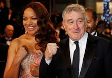 """Cast member Robert De Niro and his wife Grace Hightower de Niro pose on the red carpet as they arrive for the screening of the film """"Hands of stone"""" out of competition at the 69th Cannes Film Festival in Cannes, France, May 16, 2016. REUTERS/Jean-Paul Pelissier"""