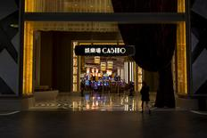 A woman walks in front of a casino at Studio City in Macau, China, October 27, 2015. REUTERS/Tyrone Siu/File photo