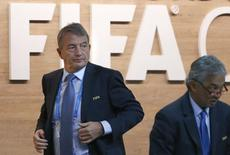FIFA executive committee member Wolfgang Niersbach walks out of the stage during the Extraordinary FIFA Congress in Zurich, Switzerland February 26, 2016.  REUTERS/Arnd Wiegmann