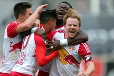 May 21, 2016; New York, NY, USA; New York Red Bulls midfielder Dax McCarty (11) reacts with teammates after a goal by New York Red Bulls midfielder Gonzalo Veron (30) during the second half against New York City FC at Yankee Stadium. The Red Bulls defeated New York City 7-0. Mandatory Credit: Brad Penner-USA TODAY Sports
