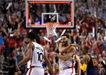 May 21, 2016; Toronto, Ontario, CAN;  Toronto Raptors guard Cory Joseph (6) reacts after guard DeMar DeRozan (10) hit a three point shot against Cleveland Cavaliers in game three of the Eastern conference finals of the NBA Playoffs at Air Canada Centre. Mandatory Credit: Dan Hamilton-USA TODAY Sports