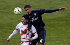 Real Madrid's Raphael Varane (R) and Rayo Vallecano's Nicolas 'Miku' Fedor in action. Spanish Liga BBVA - Rayo Vallecano v Real Madrid - Vallecas stadium, Madrid, Spain - 23/04/16. REUTERS/Sergio Perez