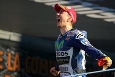 Spanish new World Champion Yamaha MotoGP rider Jorge Lorenzo celebrates after winning the Valencia Motorcycle Grand Prix at the Ricardo Tormo racetrack in Cheste, near Valencia, November 8, 2015. REUTERS/Heino Kalis