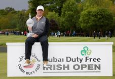 Northern Ireland's Rory McIlroy celebrates with the trophy after winning the Dubai Duty Free Irish Open. Dubai Duty Free Irish Open - The K Club, County Kildare, Ireland - 22/5/16. Action Images via Reuters / Paul Childs Livepic