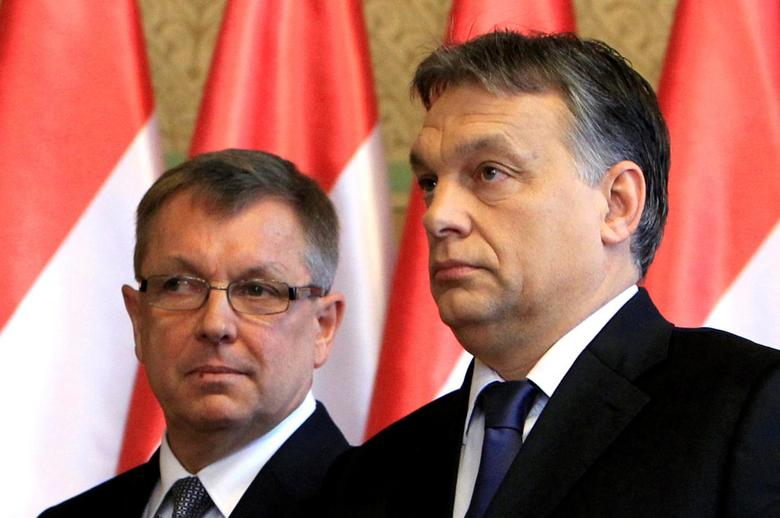 Hungarian Prime Minister Viktor Orban and central bank Governor Gyorgy Matolcsy leave after a joint news conference in Budapest, December 18, 2014. REUTERS/Bernadett Szabo/File Photo