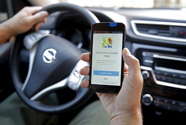 A man holds a smartphone, with the Google Maps app open, in Sarajevo, April 15, 2015. REUTERS/Dado Ruvic