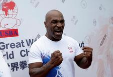 Former boxer Mike Tyson reacts as he speaks to the media, before the weigh-in of International Boxing Federation (IBF) World Championship Bout at the Mutianyu section of the Great Wall of China, on the outskirts of Beijing, China, May 24, 2016. REUTERS/Jason Lee