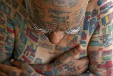 Guinness Rishi, 74, multiple world record holder including most flags tattooed on his body, poses for a photograph outside his apartment in New Delhi, India May 20, 2016. REUTERS/Cathal McNaughton