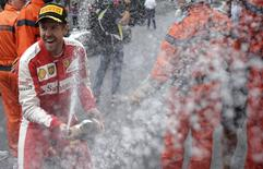 Ferrari Formula One driver Sebastian Vettel of Germany sprays champagne after getting the second place in the Monaco F1 Grand Prix May 24, 2015.  REUTERS/Max Rossi