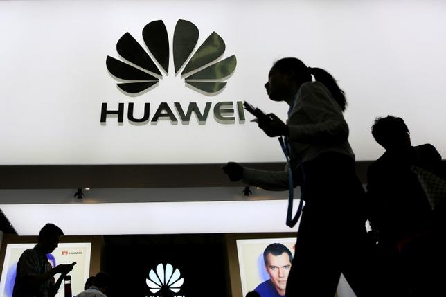 People walk past a sign board of Huawei at CES (Consumer Electronics Show) Asia 2016 in Shanghai, China May 12, 2016. REUTERS/Aly Song