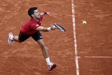 Tennis - French Open Men's Singles Quarterfinal match - Roland Garros - Novak Djokovic of Serbia vs Tomas Berdych of the Czech Republic - Paris, France - 02/06/16. Djokovic returns a shot. REUTERS/Jacky Naegelen