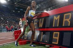 Athletics - Women's 5000 meters - Golden Gala IAAF Diamond League - Olympic stadium, Rome, Italy 02/06/2016 - Ethiopia Almaz Ayana pose near time board. REUTERS/Alessandro Bianchi