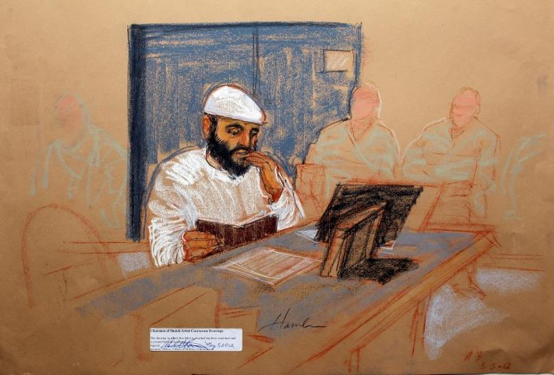 Yemeni Ramzi bin al Shibh appears at his arraignment as an accused 9/11 co-conspirator in this courtroom sketch reviewed and approved for release by a U.S. military security official, at Guantanamo Bay Navy Base, Cuba, May 5, 2012.   REUTERS/Janet Hamlin/Pool