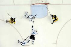 Jun 1, 2016; Pittsburgh, PA, USA; Pittsburgh Penguins center Nick Bonino (13) passes the puck to right wing Phil Kessel (81) who scores a goal past San Jose Sharks defenseman Roman Polak (46) and goalie Martin Jones (31) in the second period in game two of the 2016 Stanley Cup Final at Consol Energy Center. Don Wright-USA TODAY Sports