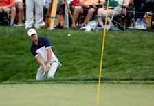 Jun 5, 2016; Dublin, OH, USA; Rory McIlroy hits out of the eighteenth bunker onto the green during the final round of The Memorial Tournament at Muirfield Village Golf Club. Mandatory Credit: Joe Maiorana-USA TODAY Sports