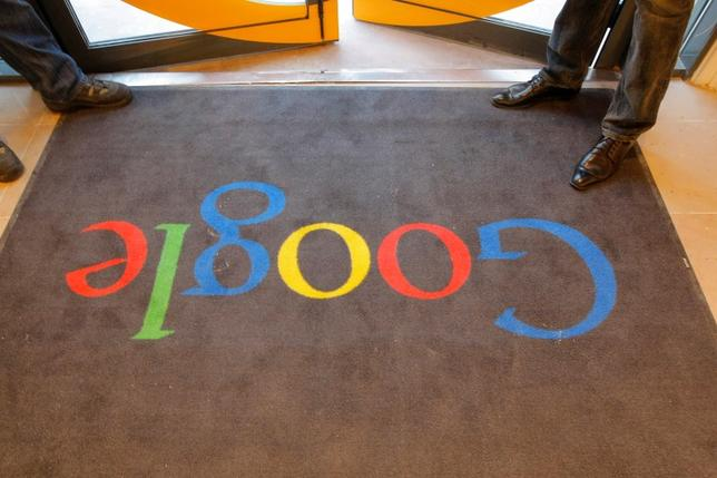 A Google carpet is seen at the entrance of the new headquarters of Google France before its official inauguration in Paris, France December 6, 2011. REUTERS/Jacques Brinon/Pool/File Photo