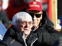 Formula One Chief Executive Bernie Ecclestone (L) reacts next to Former Formula One champion Niki Lauda as they watch the men's Alpine Skiing World Cup Super G race on the Streif course in Kitzbuehel, Austria, January 22, 2016.      REUTERS/Leonhard Foeger