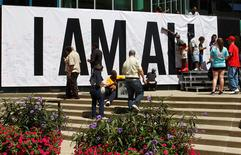 Fans of the late Muhammad Ali sign a large banner at the I AM ALI event to celebrate his life at the Kentucky Center of the Performing Arts in Louisville, Kentucky, U.S. June 8, 2016.  REUTERS/John Sommers II