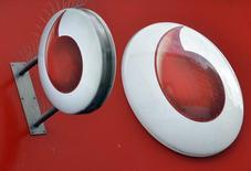 Vodafone branding is seen outside a retail store in London November 12, 2013.    REUTERS/Toby Melville/File Photo