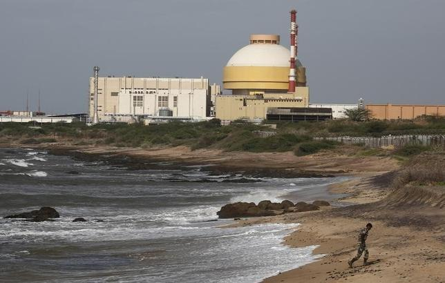 A policeman walks on a beach near Kudankulam nuclear power project in the southern Indian state of Tamil Nadu September 13, 2012. REUTERS/Adnan Abidi/files