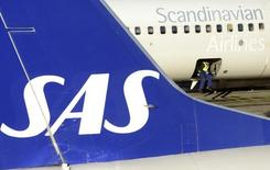 A loader sits in the cargo bay of an SAS Boeing 737 aircraft parked at Arlanda airport's Terminal Five, north of Stockholm November 13, 2012.  REUTERS/Johan Nilsson/Scanpix