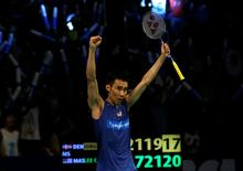 Malaysia's Lee Chong Wei celebrates after his match against Denmark's Jan O Jorgensen. REUTERS/Darren Whiteside