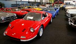 A 1973 Ferrari Dino 246 GT (front) is shown with other vintage cars during a preview of an auction by Swiss Oldtimer Galerie International in Zurich, Switzerland June 10, 2016.    REUTERS/Arnd Wiegmann