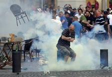 A teargas grenade explodes near an England fan ahead of England's EURO 2016 match in Marseille, France, June 10, 2016.     REUTERS/Jean-Paul Pelissier