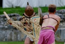 """Members of the """"Familia Gladiatoria Carnuntina"""" fight in the historic amphitheatre during the Roman Festival at the archeological site of Carnuntum in Petronell, Austria, June 11, 2016.   REUTERS/Leonhard Foeger"""