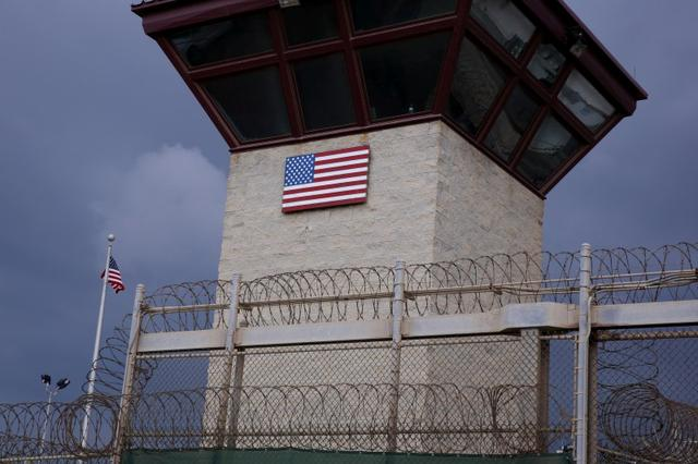 The United States flag decorates the side of a guard tower inside of Joint Task Force Guantanamo Camp VI at the U.S. Naval Base in Guantanamo Bay, Cuba March 22, 2016.  REUTERS/Lucas Jackson/File Photo