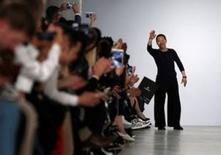 Designer Zio Song acknowledges the audience at the end of his SONGZIO catwalk show in London, Britain June 13, 2016. REUTERS/Neil Hall
