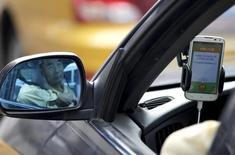 Le spécialiste chinois des véhicules de tourisme avec chauffeur (VTC) Didi Chuxing Technology, concurrent direct d'Uber en Chine, a levé sept milliards de dollars (6,2 milliards d'euros) lors de son dernier tour de table en date, rapporte mercredi le Wall Street Journal. /Photo prise le 22 septembre 2015/REUTERS/Jason Lee