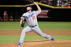 Los Angeles Dodgers starting pitcher Clayton Kershaw (22) throws during the first inning against the Arizona Diamondbacks at Chase Field. Mandatory Credit: Matt Kartozian-USA TODAY Sports