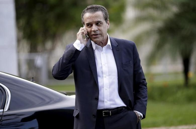 Brazilian Minister of Tourism Henrique Eduardo Alves talks on his mobile phone after a meeting with Brazil's then Vice President Michel Temer (not pictured) in Brasilia, Brazil, December 14, 2015.  REUTERS/Ueslei Marcelino
