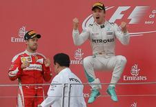 Formula One - Grand Prix of Europe - Baku, Azerbaijan - 19/6/16 - Mercedes Formula One driver Nico Rosberg (R) of Germany celebrates winning the race next to second placed Ferrari Formula One driver Sebastian Vettel of Germany.  REUTERS/Maxim Shemetov