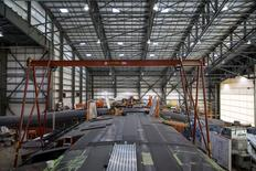 The Vulcan Aerospace's Stratolaunch rockets wing assembly is shown under construction by Northrop Grumann Scaled Composites at the Mojave Air and Space Port in Mojave, California, U.S. in this handout photo released to Reuters June 19, 2016.  Vulcan Industries/Handout via Reuters