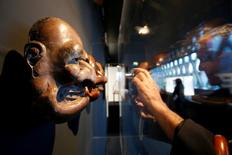 "A visitor takes a picture of a Bugaku Japanese mask (18eme) from traditional Kyogen comic theatre that is displayed during the exhibition ""Jacques Chirac ou le dialogue des cultures"" at the Musee du quai Branly in Paris, France, June 20, 2016. REUTERS/Jacky Naegelen"