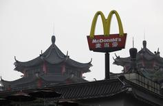 A McDonald's sign is displayed outside its outlet, the first one which opened in China in 1990, at the southern Chinese city of Shenzhen neighbouring Hong Kong March 18, 2013.  REUTERS/Bobby Yip/File Photo