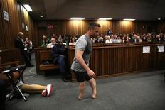 Paralympic gold medalist Oscar Pistorius walks across the courtroom without his prosthetic legs during the third day of the resentencing hearing for the 2013 murder of his girlfriend Reeva Steenkamp, at Pretoria High Court, South Africa June 15, 2016. REUTERS/Siphiwe Sibeko